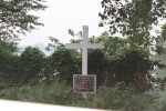 Cross marking the spot where Carey performed his first baptism in India.